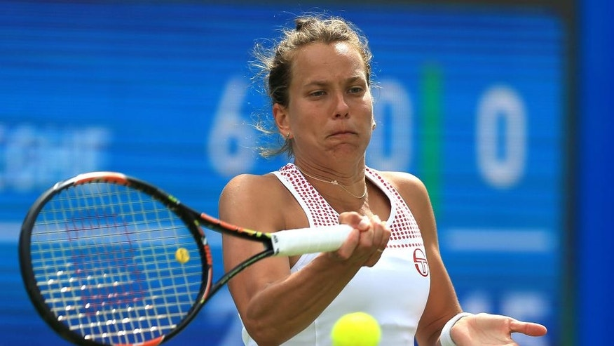 Czech Republic's Barbora Strycova returns a shot to Coco Vandeweghe, of the US, on day six of the Birmingham Classic women's tennis tournament at the Edgbaston Priory, Birmingham, central England, Saturday June 18, 2016. (Nigel French/PA via AP) UNITED KINGDOM OUT