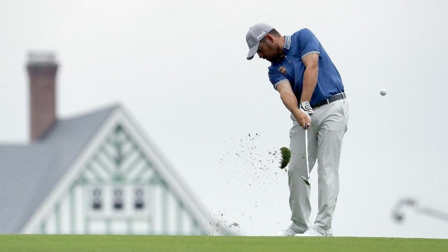Louis Oosthuizen, of South Africa, hits from the fairway on the first hole during the rain delayed first round of the U.S. Open golf championship at Oakmont Country Club on Friday, June 17, 2016, in Oakmont, Pa. (AP Photo/Charlie Riedel)