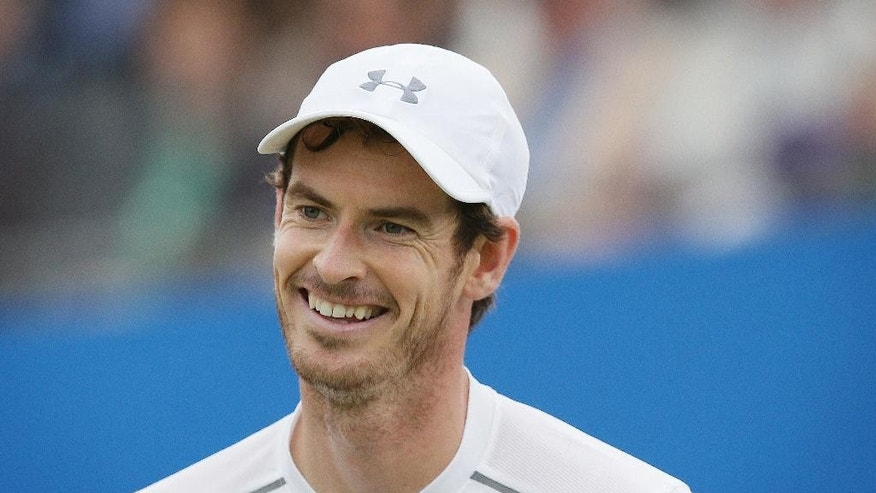 Britain's Andy Murray smiles as he plays Croatia's Marin Cilic during their semifinal tennis match on the sixth day of the Queen's Championships London, England, Saturday June 18, 2016. (AP Photo/Tim Ireland)