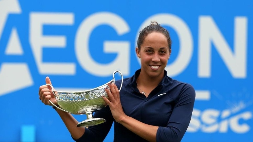 USA's Madison Keys celebrates defeating Czech Republic's Barbora Strycova and winning the singles final of the Birmingham Classic women's tennis tournament at the Edgbaston Priory, Birmingham, central England, Saturday June 18, 2016. (Simon Cooper/PA via AP) UNITED KINGDOM OUT