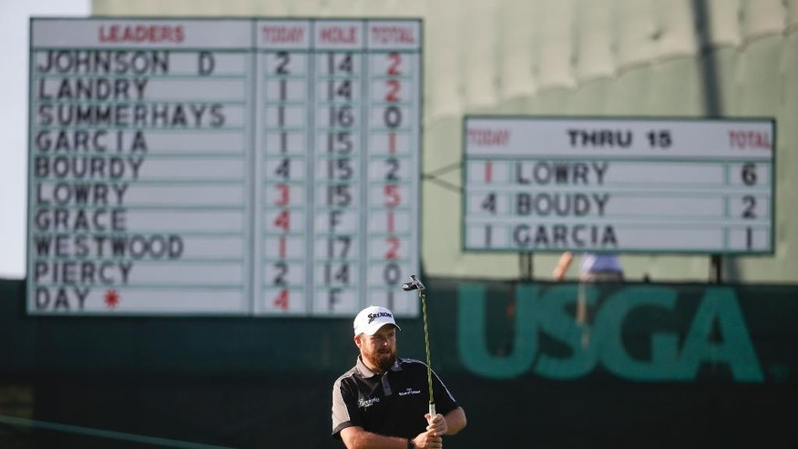 Shane Lowry, of Republic of Ireland, watches his putt on the 16th hole during the delayed third round of the U.S. Open golf championship at Oakmont Country Club on Sunday, June 19, 2016, in Oakmont, Pa. (AP Photo/John Minchillo)
