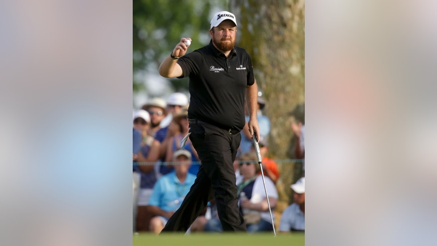 Shane Lowry, of Republic of Ireland, waves after making a putt on the ninth hole during third round of the U.S. Open golf championship at Oakmont Country Club on Saturday, June 18, 2016, in Oakmont, Pa. (AP Photo/John Minchillo)