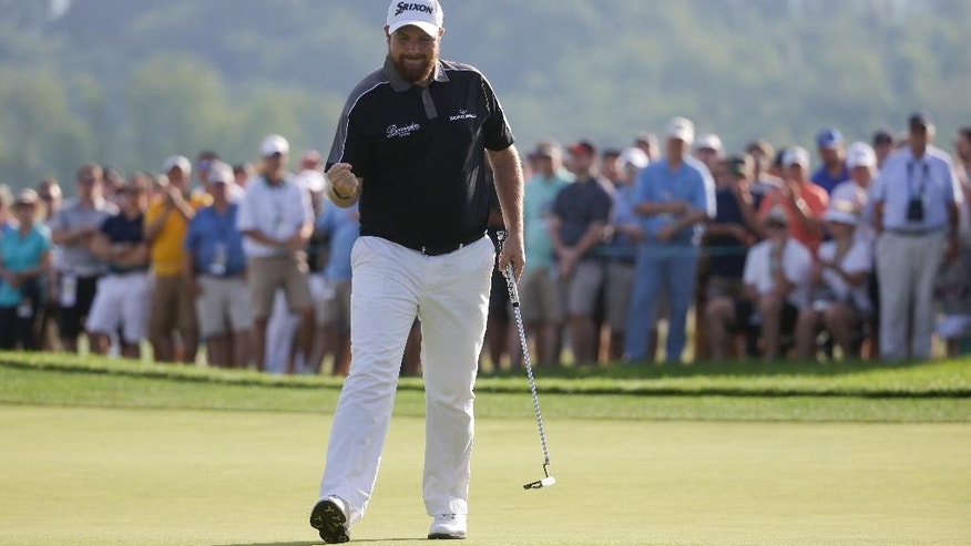 Shane Lowry, of Republic of Ireland, reacts after making a birdie on the 17th hole during the delayed third round of the U.S. Open golf championship at Oakmont Country Club on Sunday, June 19, 2016, in Oakmont, Pa. (AP Photo/John Minchillo)