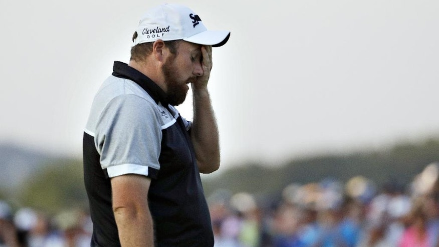 Shane Lowry, of the Republic of Ireland, wipes his face after finishing the final round of the U.S. Open golf championship at Oakmont Country Club on Sunday, June 19, 2016, in Oakmont, Pa. Dustin Johnson won. (AP Photo/Charlie Riedel)