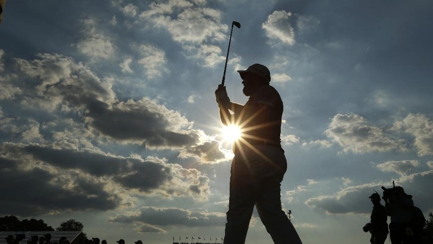 Shane Lowry, of the Republic of Ireland, watches his tee shot on the 14th hole during the final round of the U.S. Open golf championship at Oakmont Country Club on Sunday, June 19, 2016, in Oakmont, Pa. (AP Photo/Charlie Riedel)