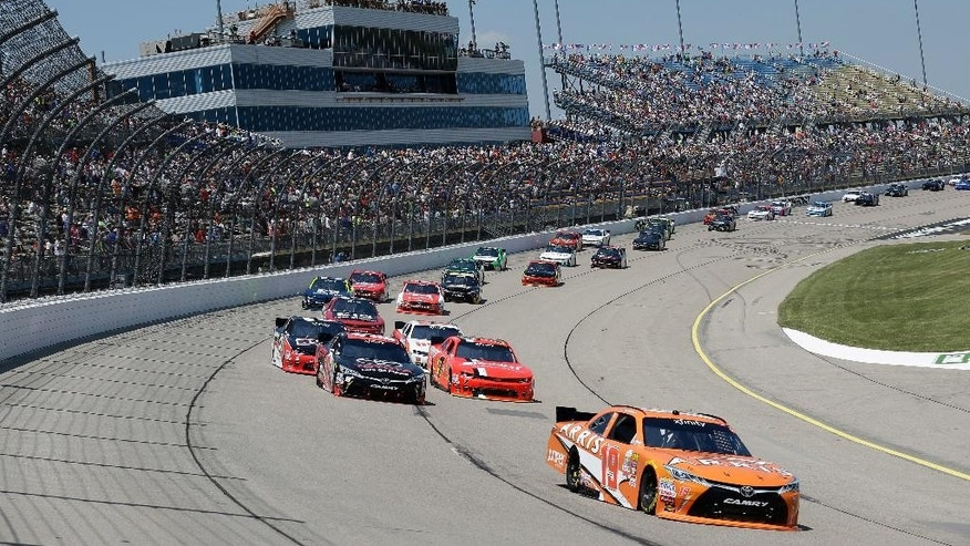 Daniel Suarez (19) leads the field during the NASCAR Xfinity Series auto race, Sunday, June 19, 2016, at Iowa Speedway in Newton, Iowa. (AP Photo/Charlie Neibergall)