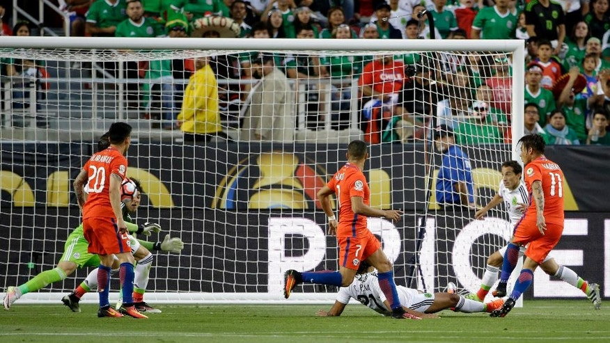 Chile's Eduardo Vargas, right, scores against Mexico during a Copa America Centenario quarterfinal soccer match at Levi's Stadium in Santa Clara, Calif., Saturday, June 18, 2016. (AP Photo/ Marcio Jose Sanchez)