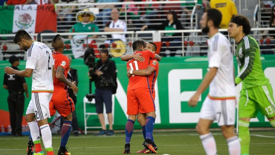 Chile's Eduardo Vargas, 11, is congratulated after scoring his side's 2nd goal against Mexico during a Copa America Centenario quarterfinal soccer match at Levi's Stadium in Santa Clara, Calif., Saturday, June 18, 2016. (AP Photo/ Marcio Jose Sanchez)