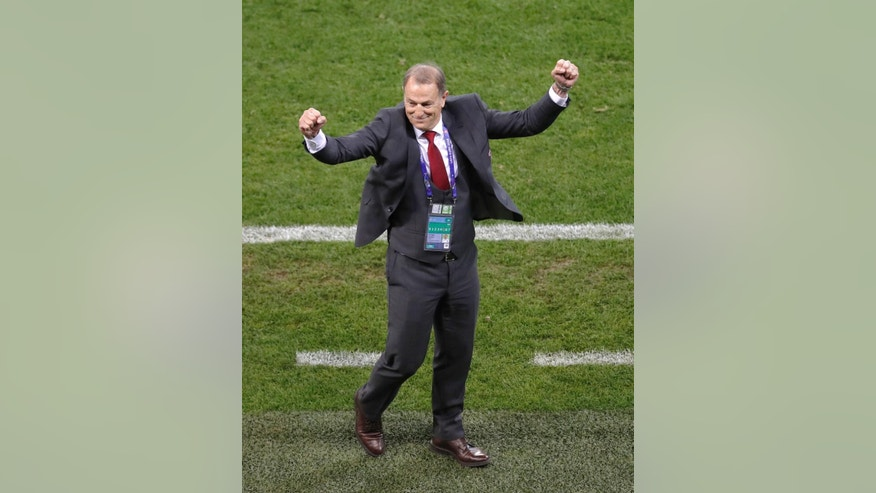 Albania coach Gianni De Biasi celebrates after the Euro 2016 Group A soccer match between Romania and Albania at the Grand Stade in Decines-Charpieu, near Lyon, France, Sunday, June 19, 2016. (AP Photo/Michael Sohn)