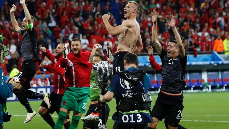 Albanian players celebrate their victory after Euro 2016 Group A soccer match between Romania and Albania at the Grand Stade in Decines-­Charpieu, near Lyon, France, Sunday, June 19, 2016. Albania won 1-0. (AP Photo/Laurent Cipriani)