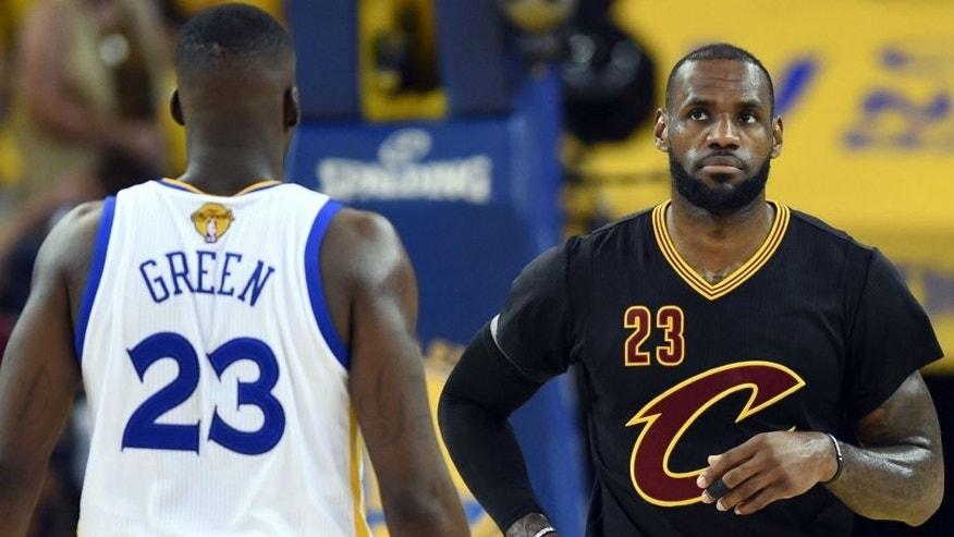 Jun 19, 2016; Oakland, CA, USA; Cleveland Cavaliers forward LeBron James (23) and Golden State Warriors forward Draymond Green (23) during the first quarter in game seven of the NBA Finals at Oracle Arena. Mandatory Credit: Bob Donnan-USA TODAY Sports