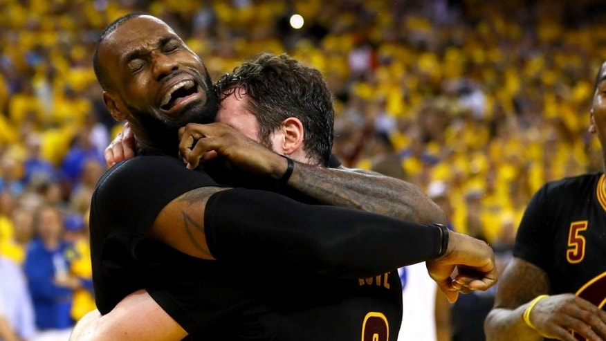 <p>OAKLAND, CA - JUNE 19: LeBron James #23 and Kevin Love #0 of the Cleveland Cavaliers celebrate after defeating the Golden State Warriors 93-89 in Game 7 of the 2016 NBA Finals at ORACLE Arena on June 19, 2016 in Oakland, California. NOTE TO USER: User expressly acknowledges and agrees that, by downloading and or using this photograph, User is consenting to the terms and conditions of the Getty Images License Agreement. (Photo by Ezra Shaw/Getty Images)</p>