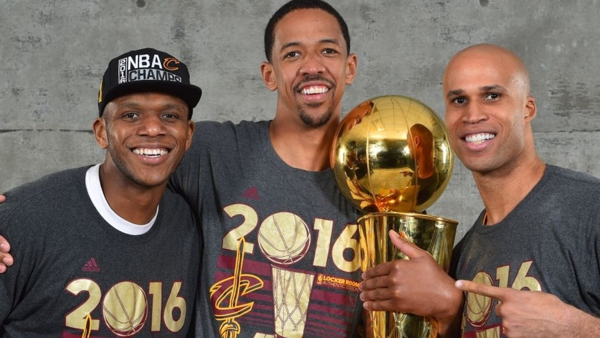 OAKLAND, CA - JUNE 19: James Jones #1, Channing Frye #9 and Richard Jefferson #24 of the Cleveland Cavaliers poses for a portrait after winning the NBA Championship against the Golden State Warriors during the 2016 NBA Finals Game Seven on June 19, 2016 at ORACLE Arena in Oakland, California. NOTE TO USER: User expressly acknowledges and agrees that, by downloading and or using this photograph, User is consenting to the terms and conditions of the Getty Images License Agreement. Mandatory Copyright Notice: Copyright 2016 NBAE (Photo by Jesse D. Garrabrant/NBAE via Getty Images)