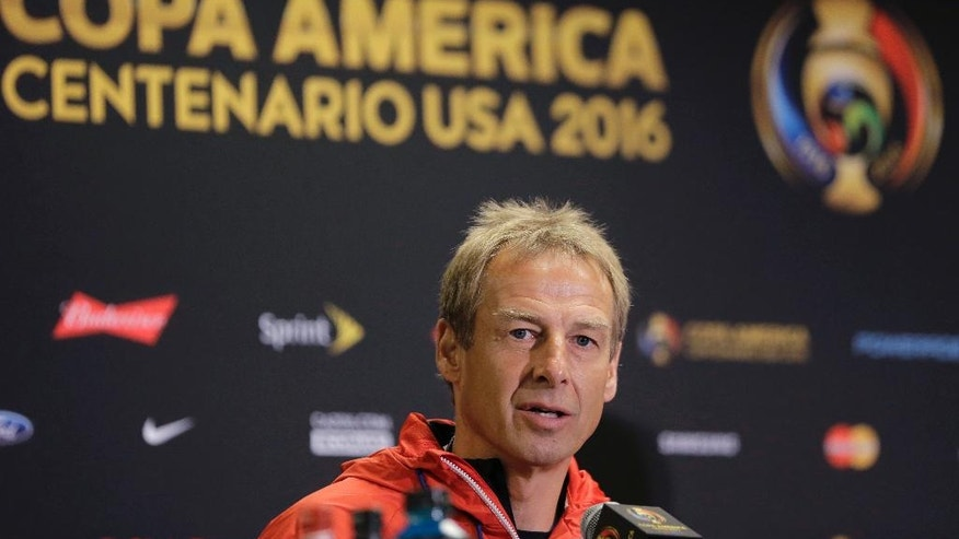 U.S. men's soccer coach Jurgen Klinsmann talks to reporters during a Copa America Centenario news conference, Monday, June 20, 2016, in Houston. The United States is scheduled to face Argentina in a Tuesday semifinal. (AP Photo/Eric Gay)