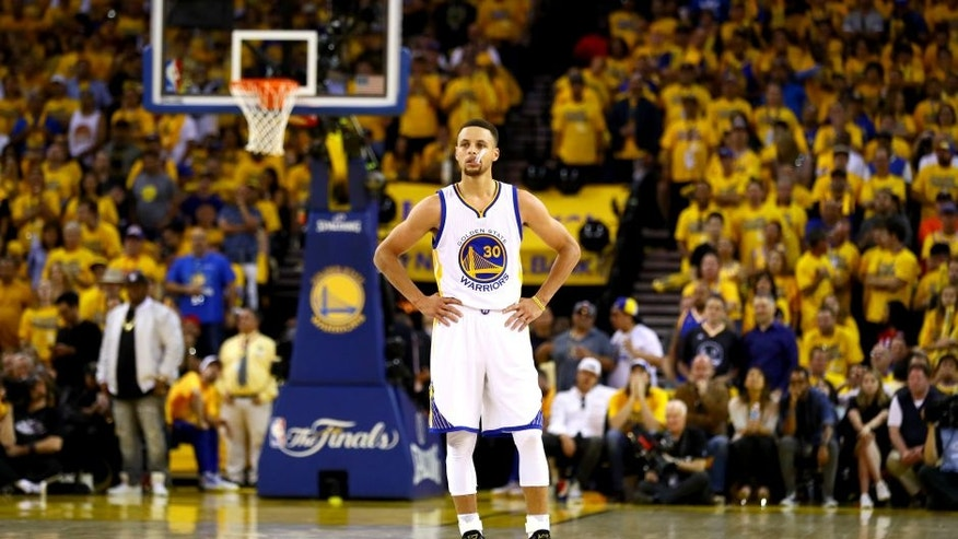 OAKLAND, CA - JUNE 19: Stephen Curry #30 of the Golden State Warriors stands on the court against the Cleveland Cavaliers in Game 7 of the 2016 NBA Finals at ORACLE Arena on June 19, 2016 in Oakland, California. NOTE TO USER: User expressly acknowledges and agrees that, by downloading and or using this photograph, User is consenting to the terms and conditions of the Getty Images License Agreement. (Photo by Ezra Shaw/Getty Images)