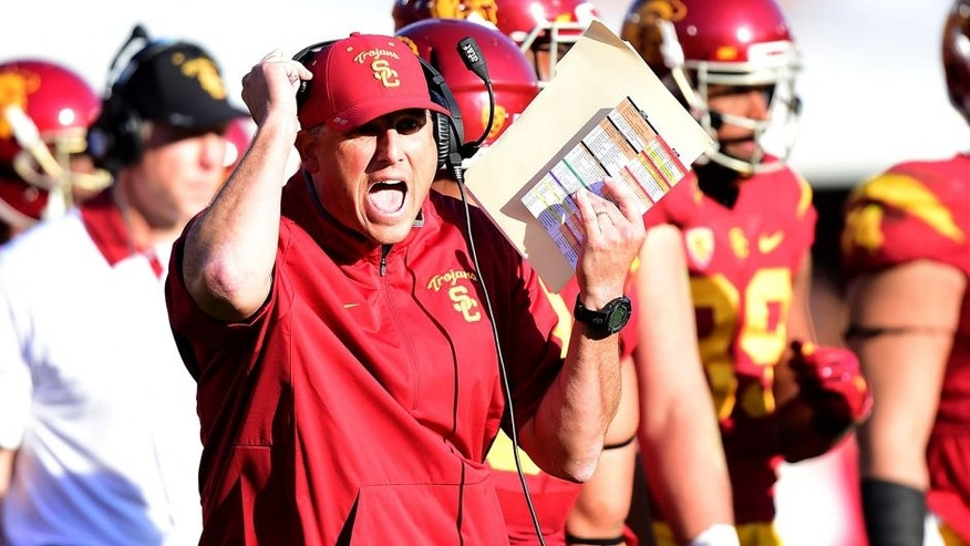 "<p>LOS ANGELES, CA - NOVEMBER 28: Head coach Clay Helton of the USC Trojans reacts on the sidelines during a 40-21 win over the UCLA Bruins at Los Angeles Memorial Coliseum on November 28, 2015 in Los Angeles, California. (Photo by Harry How/Getty Images)</p> <div><span style=""color: rgb(26, 26, 26); font-family: ""Helvetica Neue"", Helvetica, Arial, sans-serif; line-height: 18px; background-color: rgb(255, 255, 255);""> </span></div>"