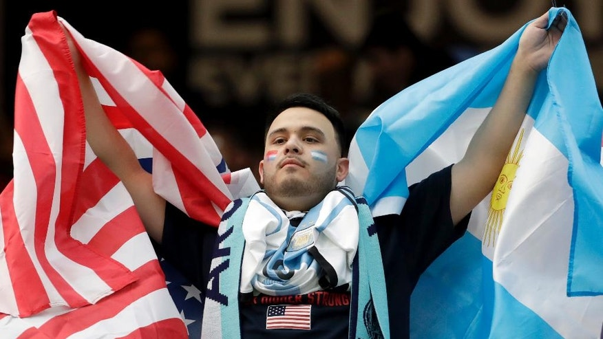 A soccer fans shows pride for both sides before a Copa America Centenario semifinal soccer match between the United States and Argentina Tuesday, June 21, 2016, in Houston. (AP Photo/David J. Phillip)