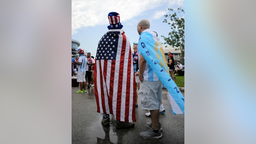 United States and Argentina fans tailgate outside the stadium before a Copa America Centenario soccer semifinal between the United States and Argentina, Tuesday, June 21, 2016, in Houston. (AP Photo/Eric Gay)