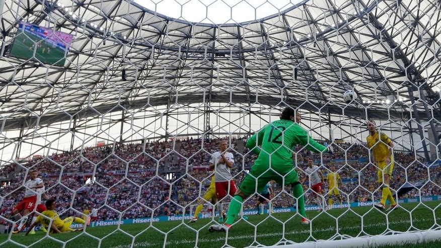 Poland's Jakub Blaszczykowski, left, scores his side's first goal during the Euro 2016 Group C soccer match between Ukraine and Poland at the Velodrome stadium in Marseille, France, Tuesday, June 21, 2016. (AP Photo/Ariel Schalit)