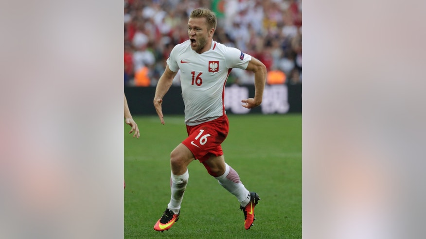 Poland's Jakub Blaszczykowski celebrates scoring his side's first goal during the Euro 2016 Group C soccer match between Ukraine and Poland at the Velodrome stadium in Marseille, France, Tuesday, June 21, 2016. (AP Photo/Ariel Schalit)