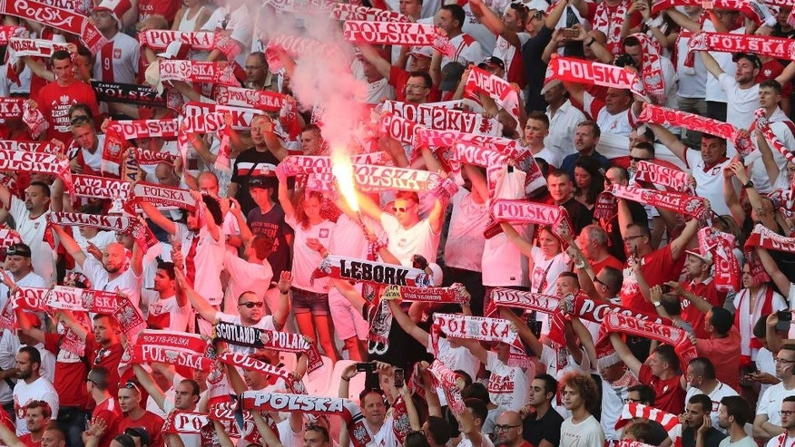 A crowd of Polish soccer supporters reacts  during the Euro 2016 Group C soccer match between Ukraine and Poland at the Velodrome stadium in Marseille, France, Tuesday, June 21, 2016. (AP Photo/Claude Paris)