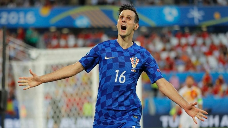 Croatia's Nikola Kalinic celebrates after scoring his side's first goal during the Euro 2016 Group D soccer match between Croatia and Spain at the Nouveau Stade in Bordeaux, France, Tuesday, June 21, 2016. (AP Photo/Manu Fernandez)