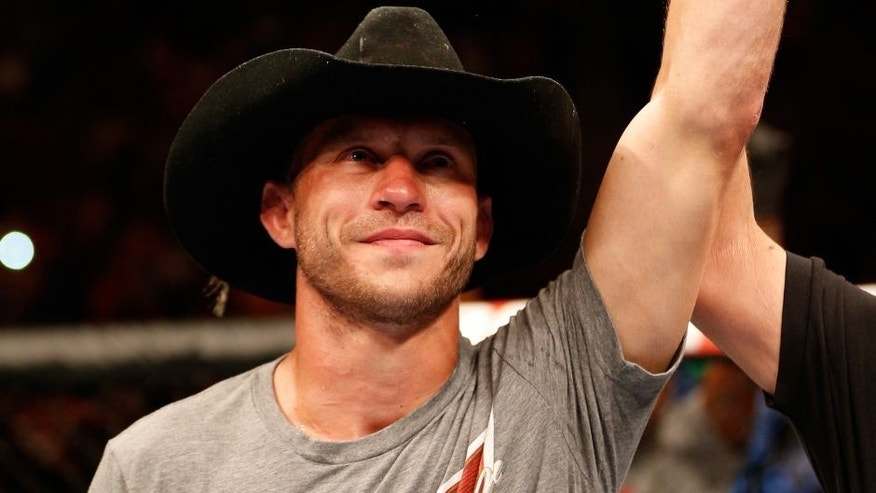 "ORLANDO, FL - APRIL 19: Donald ""Cowboy"" Cerrone reacts after his submission victory over Edson Barboza in their lightweight bout during the FOX UFC Saturday event at the Amway Center on April 19, 2014 in Orlando, Florida. (Photo by Josh Hedges/Zuffa LLC/Zuffa LLC via Getty Images)"