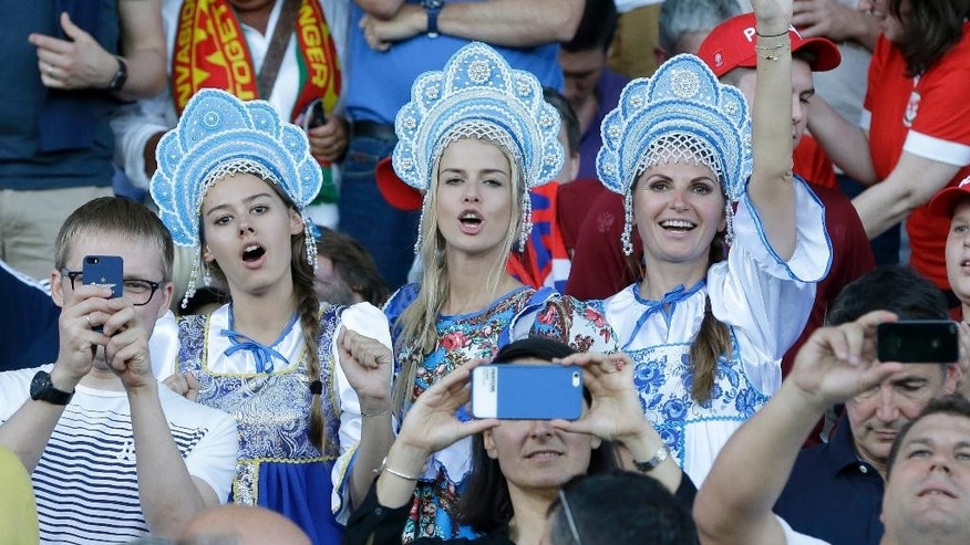 Russian fans wearing traditional outfits cheer from the stands before the Euro 2016 Group B soccer match between Russia and Wales at the Stadium municipal in Toulouse, France, Monday, June 20, 2016. (AP Photo/Thanassis Stavrakis)