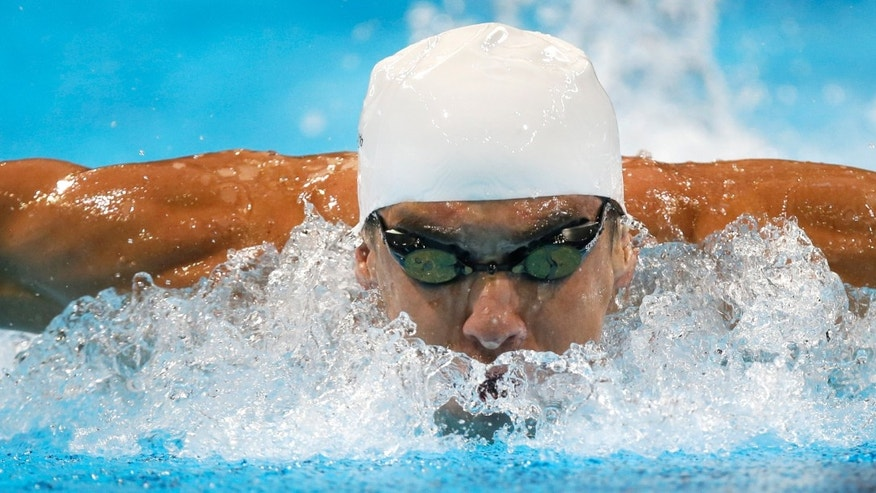 June 27, 2012: Michael Phelps swims in the men's 200-meter butterfly preliminaries at the U.S. Olympic swimming trials in Omaha, Neb. (AP)