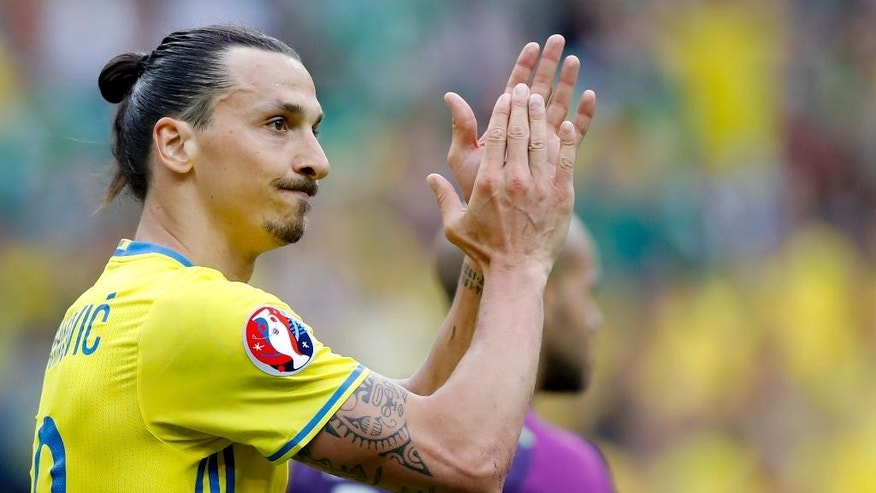 FILE - In this Monday, June 13, 2016 file photo, Sweden's Zlatan Ibrahimovic applauds  during the Euro 2016 Group E soccer match between Ireland and Sweden at the Stade de France in Saint-Denis, north of Paris, France. Ibrahimovic said Tuesday, June 21, 2016 he will retire from international football after the European Championship. (AP Photo/Christophe Ena, File)