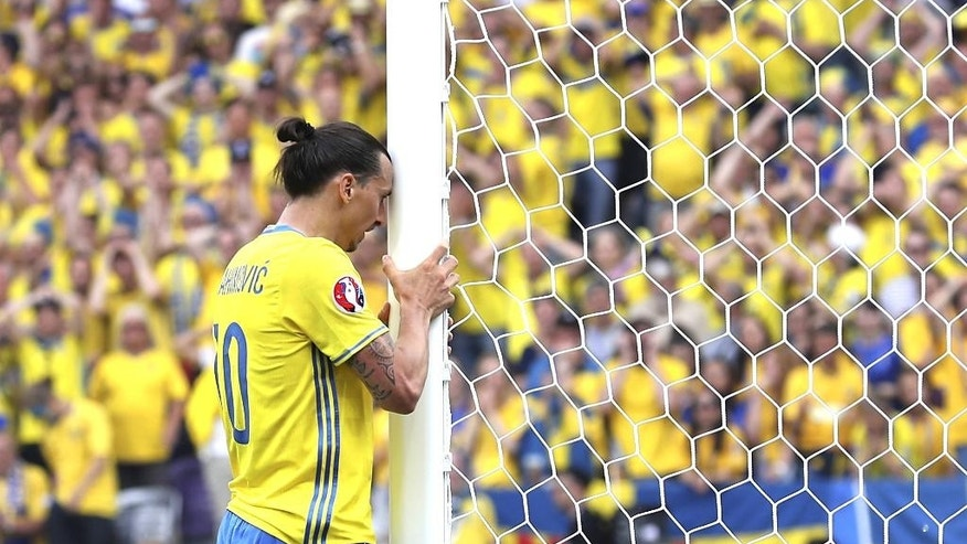 FILE - In this Friday, June 17, 2016 file photo, Sweden's Zlatan Ibrahimovic reacts after missing a scoring chance during the Euro 2016 Group E soccer match between Italy and Sweden at the Stadium municipal in Toulouse, France. (AP Photo/Antonio Calanni, File)