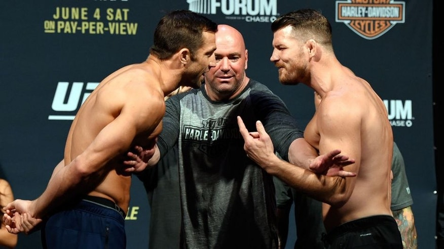 INGLEWOOD, CA - JUNE 03: (L-R) Opponents Luke Rockhold and Michael Bisping of England face off during the UFC 199 weigh-in at the Forum on June 3, 2016 in Inglewood, California. (Photo by Josh Hedges/Zuffa LLC/Zuffa LLC via Getty Images)
