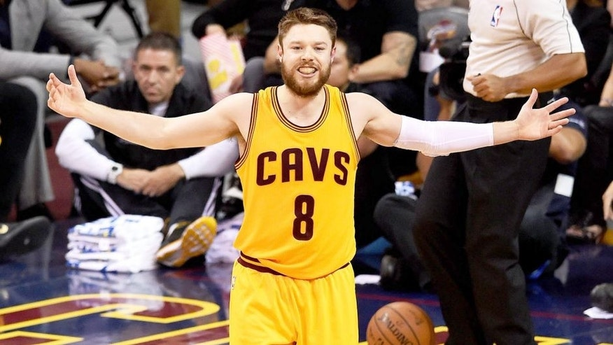 CLEVELAND, OH - JUNE 09: Matthew Dellavedova #8 of the Cleveland Cavaliers reacts against the Golden State Warriors during Game Three of the 2015 NBA Finals at Quicken Loans Arena on June 9, 2015 in Cleveland, Ohio. NOTE TO USER: User expressly acknowledges and agrees that, by downloading and or using this photograph, user is consenting to the terms and conditions of Getty Images License Agreement. (Photo by Jason Miller/Getty Images)