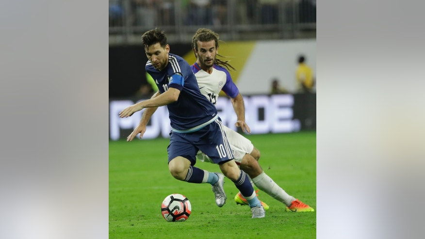 Argentina midfielder Lionel Messi (10) gets the ball past United States midfielder Kyle Beckerman (15) during a Copa America Centenario semifinal soccer match Tuesday, June 21, 2016, in Houston. (AP Photo/David J. Phillip)