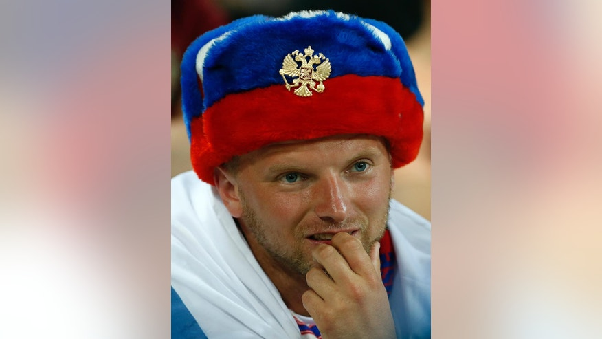 A Russian supporter looks on during the Euro 2016 Group B soccer match between Russia and Wales at the Stadium municipal in Toulouse, France, Monday, June 20, 2016. (AP Photo/Hassan Ammar)