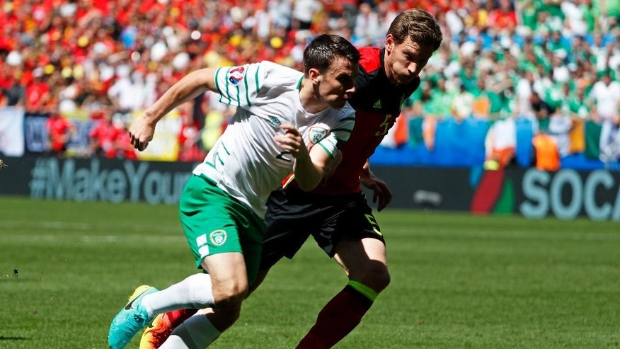 Ireland's Seamus Coleman, left, fights for the ball with Belgium's Jan Vertonghen during the Euro 2016 Group E soccer match between Belgium and Ireland at the Nouveau Stade in Bordeaux, France, Saturday, June 18, 2016. (AP Photo/Hassan Ammar)