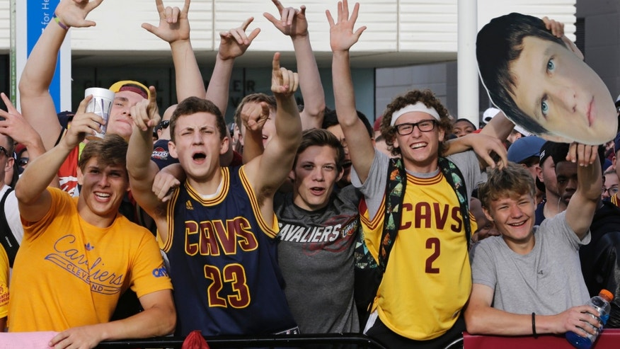 Cleveland Cavaliers fans cheering at the parade.