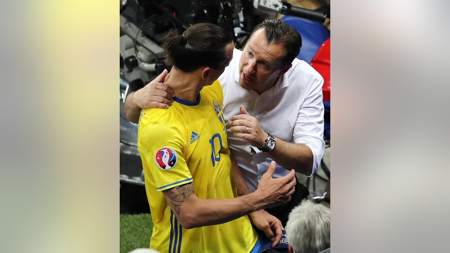 Sweden's Zlatan Ibrahimovic is greeted by Belgium coach Marc Wilmots as he leaves the field after the Euro 2016 Group E soccer match between Sweden and Belgium at the Allianz Riviera stadium in Nice, France, Wednesday, June 22, 2016. Sweden lost the match 1-0. (AP Photo/Claude Paris)