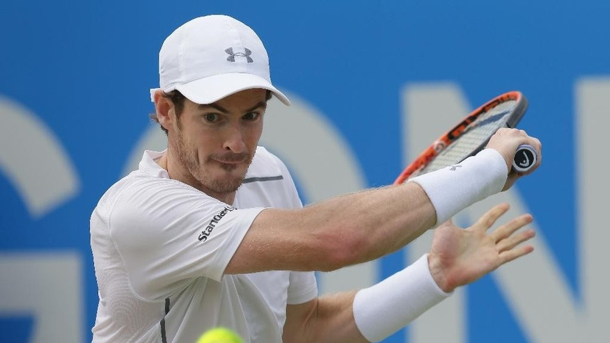 Britain's Andy Murray plays a return to Canada's Milos Raonic during their final tennis match at Queen's Championships London, England, Sunday June 19, 2016. (AP Photo/Tim Ireland)