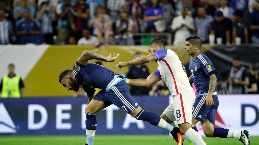 Argentina's Nicolas Otamendi (17) and United States's Clint Dempsey (8) battle during a Copa America Centenario semifinal soccer match Tuesday, June 21, 2016, in Houston. (AP Photo/David J. Phillip)
