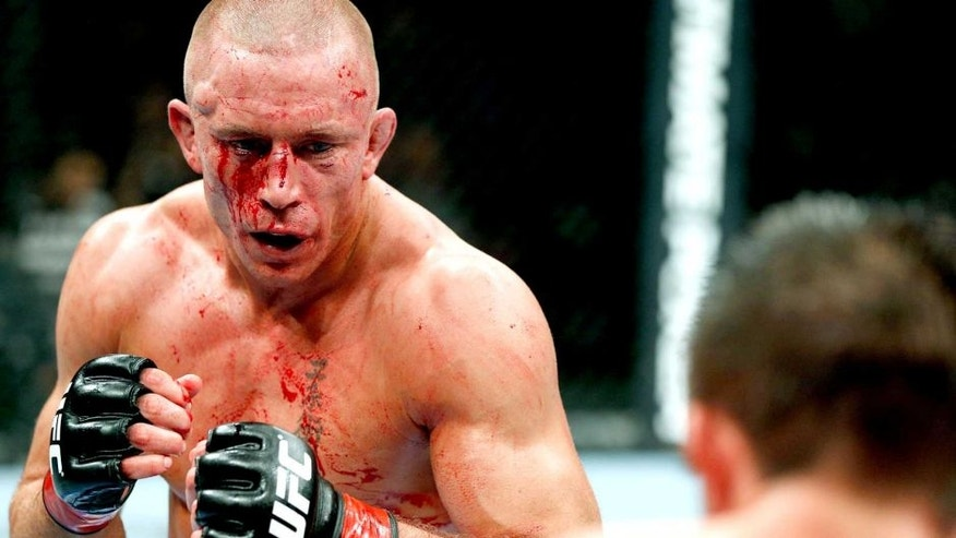 MONTREAL, QC - NOVEMBER 17: Georges St-Pierre (L) fights against Carlos Condit in their welterweight title bout during UFC 154 on November 17, 2012 at the Bell Centre in Montreal, Canada. (Photo by Josh Hedges/Zuffa LLC/Zuffa LLC via Getty Images)