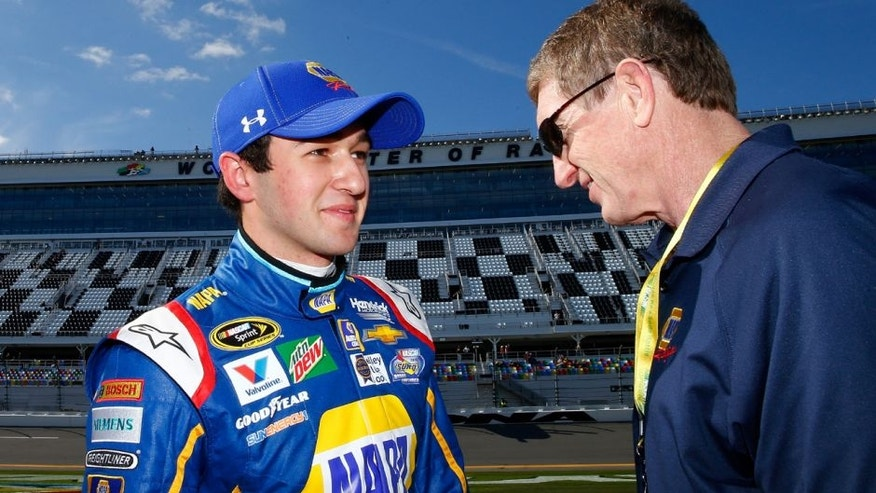 DAYTONA BEACH, FL - FEBRUARY 14: Chase Elliott, driver of the #24 NAPA Auto Parts Chevrolet, talks with his father Bill Elliott after winning the Pole Award and qualifying for the NASCAR Sprint Cup Series Daytona 500 at Daytona International Speedway on February 14, 2016 in Daytona Beach, Florida. (Photo by Jonathan Ferrey/NASCAR via Getty Images)