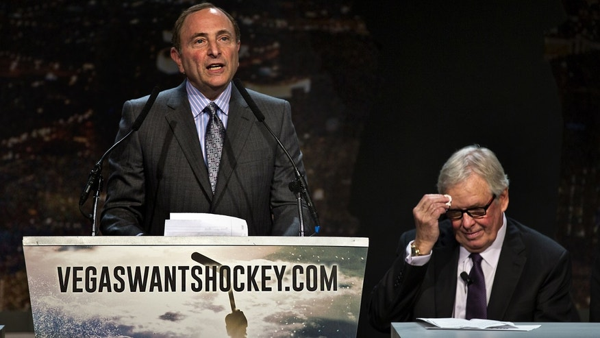 "Feb. 10, 2015: NHL Commissioner Gary Bettman speaks as Bill Foley, chairman, Fidelity National Financial, Inc., Black Knight and FIS wipes his forehead during the ""Let's Bring Hockey to Las Vegas!"" press conference at the MGM Grand Ballroom in Las Vegas."