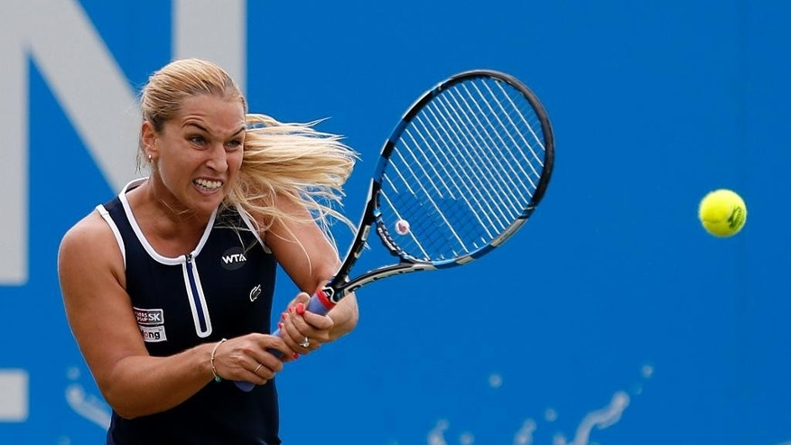 Slovakia's Dominika Cibulkova returns the ball to Ukraine's Kateryna Bondarenko during day three of the 2016 Eastbourne  International tennis tournament at at Devonshire Park, Eastbourne, England, Wednesday, June 22, 2016. (Steve Paston/PA via AP)     UNITED KINGDOM OUT      -     NO SALES      -     NO ARCHIVES
