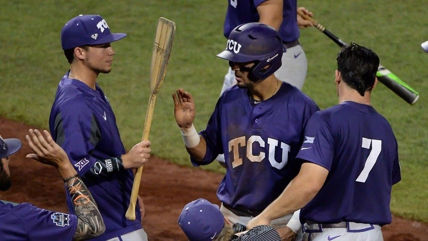Jun 21, 2016; Omaha, NE, USA; TCU Horned Frogs outfielder Dane Steinhagen (10) scores in the fifth inning on a force play against the Coastal Carolina Chanticleers in the 2016 College World Series at TD Ameritrade Park. Mandatory Credit: Steven Branscombe-USA TODAY Sports