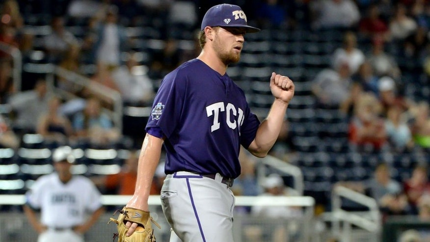 Jun 21, 2016; Omaha, NE, USA; TCU Horned Frogs pitcher Ryan Burnett (17) reacts after the win against the Coastal Carolina Chanticleers in the 2016 College World Series at TD Ameritrade Park. TCU defeated Coastal Carolina 6-1. Mandatory Credit: Steven Branscombe-USA TODAY Sports