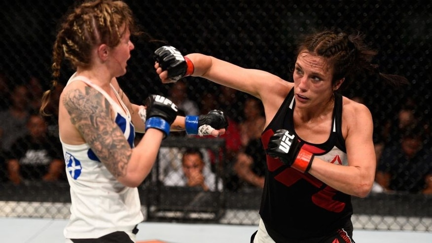 OTTAWA, ON - JUNE 18: (R-L) Valerie Letourneau of Canada punches Joanne Calderwood of Scotland in their women's flyweight bout during the UFC Fight Night event inside the TD Place Arena on June 18, 2016 in Ottawa, Ontario, Canada. (Photo by Jeff Bottari/Zuffa LLC/Zuffa LLC via Getty Images)