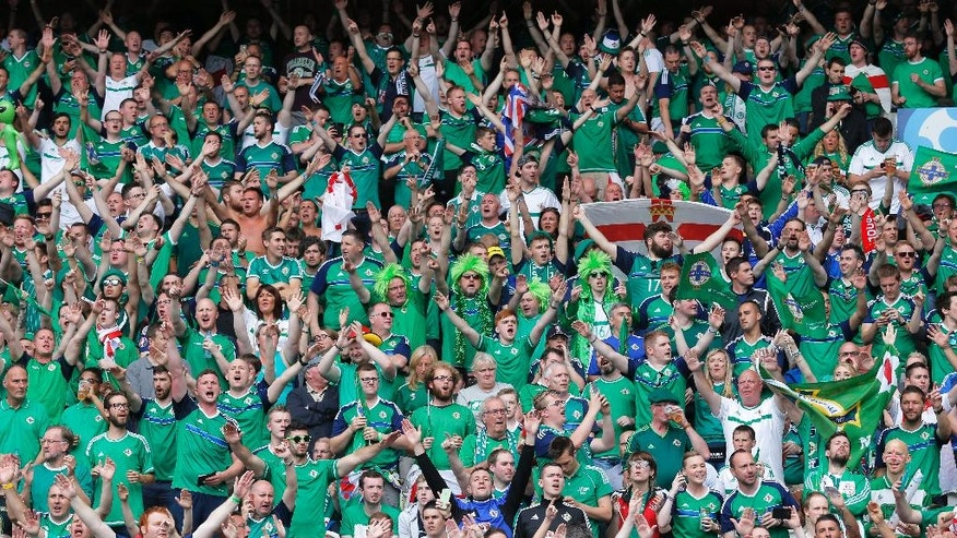 FILE - In this Tuesday, June 21, 2016 file photo, Northern Ireland supporters cheer prior to the Euro 2016 Group C soccer match between Northern Ireland and Germany at the Parc des Princes stadium in Paris. Will Grigg hasn't had any playing time yet at the European Championship, but a catchy chant featuring the Northern Ireland striker is lighting up the tournament. The 24-year-old is one of the hits of Euro 2016 thanks to the chant that has gone viral around grounds and on social media even as he remained rooted to the bench. (AP Photo/Francois Mori, File)