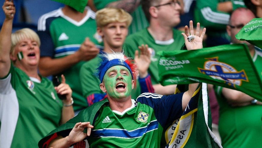 FILE - In this Tuesday, June 21, 2016 file photo, Northern Ireland supporters cheer prior to the Euro 2016 Group C soccer match between Northern Ireland and Germany at the Parc des Princes stadium in Paris. Will Grigg hasn't had any playing time yet at the European Championship, but a catchy chant featuring the Northern Ireland striker is lighting up the tournament. The 24-year-old is one of the hits of Euro 2016 thanks to the chant that has gone viral around grounds and on social media even as he remained rooted to the bench.(AP Photo/Martin Meissner, File)
