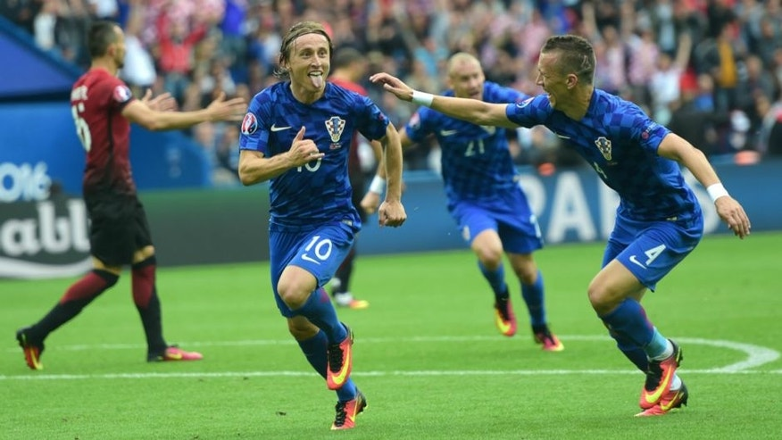Croatia's midfielder Luka Modric (C) celebrates a goal during the Euro 2016 group D football match between Turkey and Croatia at Parc des Princes in Paris on June 12, 2016. / AFP / BULENT KILIC (Photo credit should read BULENT KILIC/AFP/Getty Images)